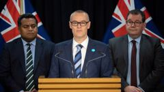 David Clark, flanked by Cabinet colleagues Kris Faafoi and Grant Robertson, announced his resignation as Health Minister this morning. Photo / Mark Mitchell