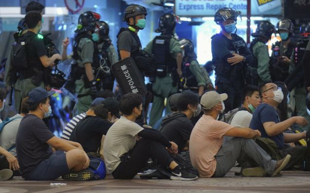 Police detain protesters during a march marking the anniversary of the Hong Kong handover from Britain to China. (Photo / AP)