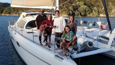 American family quits cold NZ, sails into Pacific navy blockade