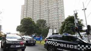 Police are enforcing a lockdown at public housing towers in Melbourne after Victoria recorded new coronavirus cases. (Photo / AAP)