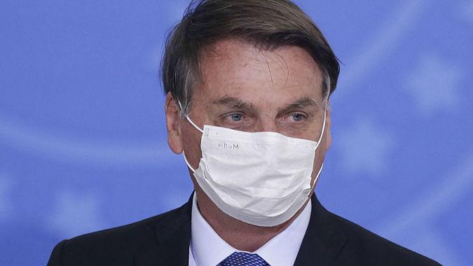 Jair Bolsonaro has long been downplaying the seriousness of Covid-19. (Photo / AP)