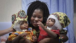 Ermine Nzotto holds her twins Ervina and Prefina Bangalo, at the Vatican pediatric hospital, in Rome, Italy. Photo / AP