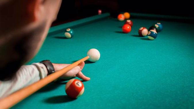 A man needed bowel surgery after allegedly being attacked with a pool cue while naked. Photo / 123RF
