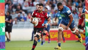 Richie Mo'unga runs in a try against the Blues. Photo / Getty