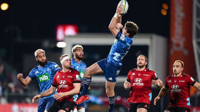 Beauden Barrett of the Blues takes a high ball against the Crusaders. Photo / Photosport