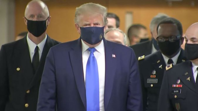 President Donald Trump paid a visit to wounded service members at Walter Reed National Military Medical Center on Saturday and wore a mask after months of refusing to be seen doing so in public. (Photo / CNN)