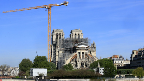 Notre Dame to be rebuilt exactly as it was after months of debate
