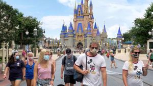 Guests wear masks as required to attend the official reopening day of the Magic Kingdom at Walt Disney World in Florida. Photo / AP