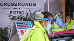 Medical staff perform tests on drivers outside the Crossroads Hotel, in the Sydney suburb of Casula. (Photo / Getty)