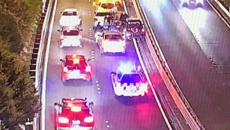 Four strangers save motorist's life after he suffers cardiac arrest, repeatedly crashing into motorway barrier
