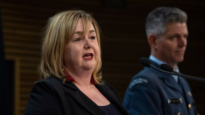 Minister in charge of isolation hotels Megan Woods and Air Commodore Digby Webb. (Photo / NZ Herald)