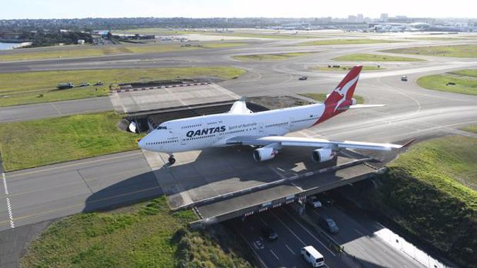 A Qantas Boeing 747-400, registration VH-OEJ taxis at Sydney Airport for the last time as it retires from service on July 22, 2020 in Sydney. Photo / Getty)