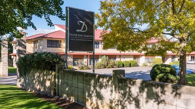 The Distinction Hotel in Hamilton where a family escaped quarantine to try and attend the funeral of a family member. (Photo / File)