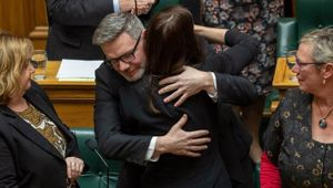 Lees-Galloway hugs Prime Minister Jacinda Ardern, who sacked him as a minister, after his valedictory speech in Parliament. Photo / Mark Mitchell