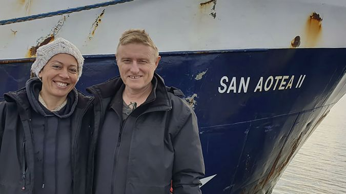 Neville and Feeonaa Clifton are pictured by the San Aotea II fishing boat in the Falkland  Islands. (Photo / Supplied via AP)