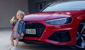 Audi has apologized for an advert showing a young girl eating a banana in front of a premium car. (Photo via CNN)