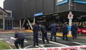 Members of the police Specialist Search Group examine the scene at the Westfield Chartwell Shopping Centre this morning. (Photo / Belinda Feek)