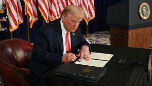 President Donald Trump signs executive orders extending coronavirus economic relief. (Photo / AFP via CNN)