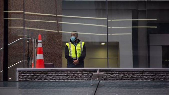 Security at the Crowne Plaza Hotel in central Auckland, used as a Covid-19 managed isolation facility. Photo / Sylvie Whinray