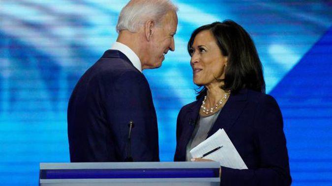 Democratic presidential candidate former Vice President Joe Biden, left, and then-candidate Sen. Kamala Harris, D-Calif. shake hands after a debate. Photo / AP