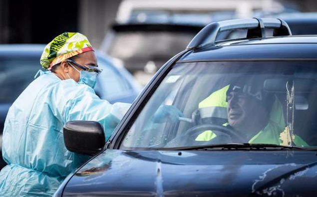 A man is tested for Covid-19 at the Otara Mall testing station. Photo / Greg Bowker