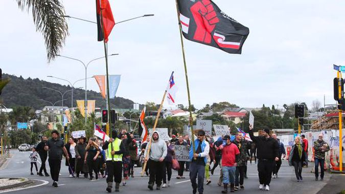 Protesters walk down Dent St in Whangārei. Photo / Tania Whyte