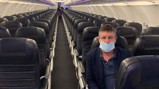 """""""The morning trip home to Wellington from Auckland ... me, myself and I ... plus another chap in the back row."""" Photo / Cameron Bagrie"""