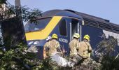Emergency services attend the scene of a derailed train in Stonehaven, Scotland. (Photo / AP)