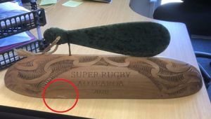 The Super Rugby trophy with damage to bottom left. Photo / Supplied