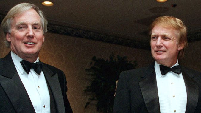 In this Nov. 3, 1999, file photo, Robert Trump, left, joins then real estate developer and presidential hopeful Donald Trump at an event in New York. (Photo via AP)