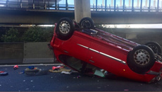 Car flips on Auckland motorway on-ramp