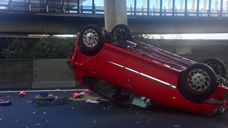 Car flips on Auckland motorway on-ramp