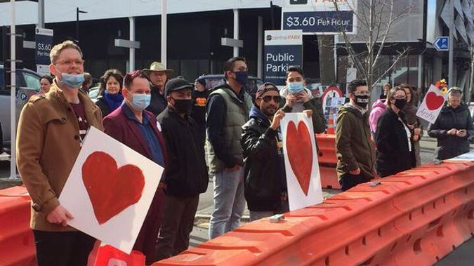 People gathered outside court this morning. Photo / Amber Allott
