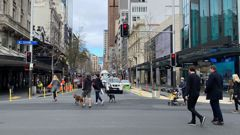Auckalnders out on Queen Street. (Photo / Courtney Winter)