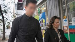 The accused outside the Auckland District Court with his lawyer Emma Priest. Photo / Brett Phibbs