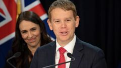 Education Minister Chris Hipkins, watched on by Prime Minister Jacinda Ardern. Photo / Mark Mitchell