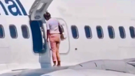 The shocking moment a passenger took a walk on aeroplane wing