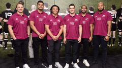 All Blacks captain Sam Cane (far left) standing with the new All Blacks caps. (Photo / Getty)