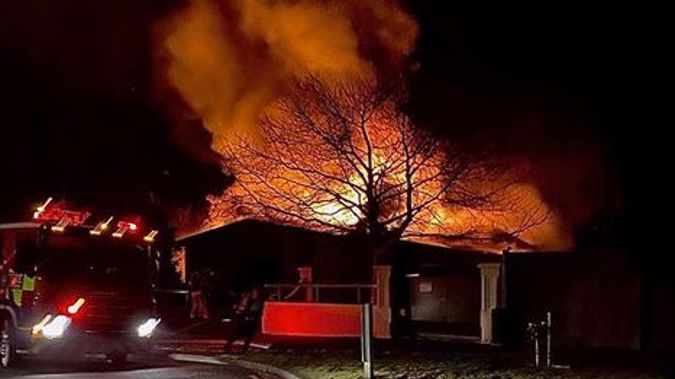 The Kingdom Hall of Jehovah's Witnesses on fire on Monday. (Photo / Jaime Moore)