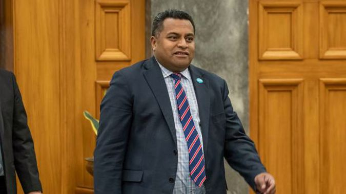 Immigration Minister Kris Faafoi on his way into the House for Question Time, Parliament. (Photo / Mark Mitchell)
