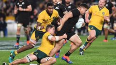 All Blacks' Codie Taylor is tackled by Wallabies captain Michael Hooper. Photo / Photosport