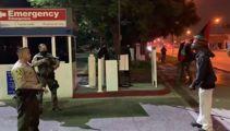 Protesters block hospital after US cops shot