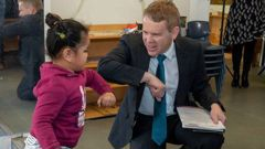 Education Minister Chris Hipkins greeting Alexia Pitoitua, aged 3, at today's education policy announcement at a Porirua childcare centre today. Photo / Mark Mitchell