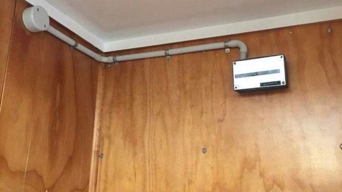 """The camera pictured on the wall and inside a box labelled """"cable junction box"""" before it was taken down by the students. Photo / Supplied"""
