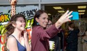 Prime Minister Jacinda Ardern posing for selfies with fans during her walkabout in Palmerston North. Photo / Mark Mitchell