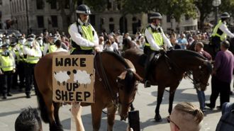 UK virus measures targeted by protesters despite case spikes