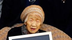 Kane Tanaka poses with her Guinness World Records certificate at a nursing home where she lives in Fukuoka. Photo / AP
