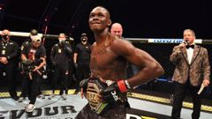 Israel Adesanya celebrates after defeating Paulo Costa to retain his UFC middleweight belt. Photo / Getty