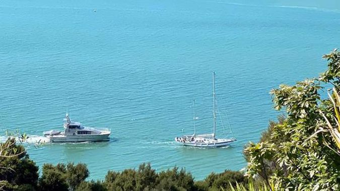 The 16-metre yacht Anita arriving in Opua on Friday afternoon escorted by New Zealand Customs patrol vessel Hawk V after the German crew arrived in the country unlawfully. Photo / Supplied