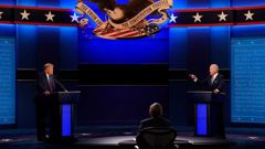 Donald Trump, left, and Joe Biden, right, during the first presidential debate with moderator Chris Wallace, centre. (Photo / AP)
